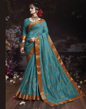 Get Ready For The Upcoming Wedding And Festive Season With This Designer Saree In Blue Color. This Attractive Jari Embroidered Saree Is Fabricated On Vichitra Silk Paired With Vichitra Silk Fabricated Blouse. It Is Beautified With Broad Lace Border With Stone Work. Buy Now.