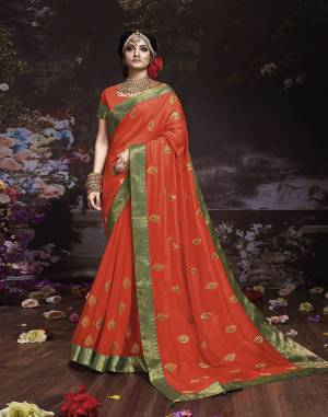 Get Ready For The Upcoming Wedding And Festive Season With This Designer Saree In Orange Color. This Attractive Jari Embroidered Saree Is Fabricated On Vichitra Silk Paired With Vichitra Silk Fabricated Blouse. It Is Beautified With Broad Lace Border With Stone Work. Buy Now.