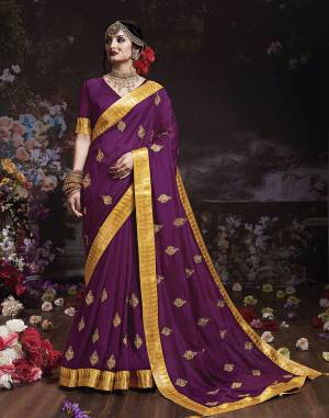 Get Ready For The Upcoming Wedding And Festive Season With This Designer Saree In Purple Color. This Attractive Jari Embroidered Saree Is Fabricated On Vichitra Silk Paired With Vichitra Silk Fabricated Blouse. It Is Beautified With Broad Lace Border With Stone Work. Buy Now.
