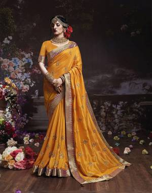 Get Ready For The Upcoming Wedding And Festive Season With This Designer Saree In Musturd Yellow Color. This Attractive Jari Embroidered Saree Is Fabricated On Vichitra Silk Paired With Vichitra Silk Fabricated Blouse. It Is Beautified With Broad Lace Border With Stone Work. Buy Now.