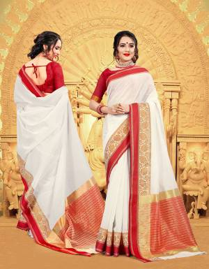 Celebrate This Festive Season Wearing This Pretty elegant Looking Saree In White And Red Color Paired With A Lovely Red Colored Blouse. This Saree And Blouse Are Khadi Silk Based Which Also Gives a Rich And Elegant Look To Your Personality.