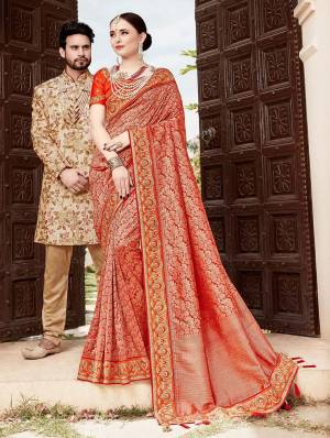 For A Proper Traditional Look, Grab This Heavy Designer Saree In Red Color Paired With Contrasting Orange Colored Blouse. This Saree Is Fabricated On Jacquard Silk Paired With Art Silk Fabricated Blouse. It Is Beautified With Heavy Embroidered Lace Border And Blouse.