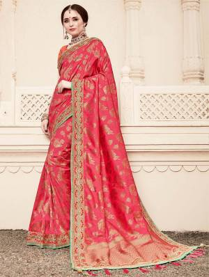 For A Proper Traditional Look, Grab This Heavy Designer Saree In Pink Color Paired With Contrasting Dark Peach Colored Blouse. This Saree Is Fabricated On Jacquard Silk Paired With Art Silk Fabricated Blouse. It Is Beautified With Heavy Embroidered Lace Border And Blouse.