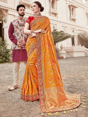 For A Proper Traditional Look, Grab This Heavy Designer Saree In Musturd Yellow Color Paired With Contrasting Red Colored Blouse. This Saree Is Fabricated On Jacquard Silk Paired With Art Silk Fabricated Blouse. It Is Beautified With Heavy Embroidered Lace Border And Blouse.
