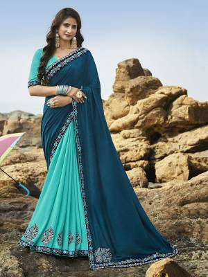 Go With The Pretty Shades Of Blue With This Blue And Turquoise Blue Colored Saree Paired With Turquoise Blue Colored Blouse. This Saree Is Fabricated Rich Soft Art Silk Beautified With Attractive Detailed Embroidery. Buy This Saree Now.