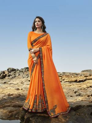 Celebrate this Festive Season Wearing This Attractive Heavy Designer Saree In Orange Color Paired With Orange Colored Blouse. This Saree Is Soft Silk Based Which Gives A Rich Look To Your Personality.