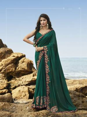 New Shade Is Here To Add Into Your Wardrobe With This Heavy Designer Saree In Teal Green Color Paired With Teal Green Colored Blouse. This Saree And Blouse Are Rich Silk Based, It Rich Fabric And Unique Color Will Definitely Earn Ypu Lots Of Compliments From Onlookers.