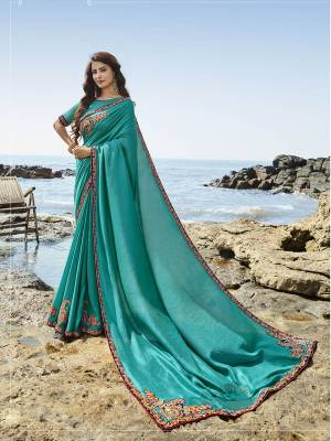 New Shade Is Here To Add Into Your Wardrobe With This Heavy Designer Saree In Turquoise Blue Color Paired With Turquoise Blue Colored Blouse. This Saree And Blouse Are Rich Silk Based, It Rich Fabric And Unique Color Will Definitely Earn Ypu Lots Of Compliments From Onlookers.
