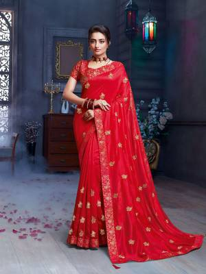Grab This Pretty Attractive Saree In Red Color. This Saree Is Fabricated On Art Silk Paired With Brocade Fabricated Blouse. Its Rich Fabric And Color Will Earn You Lots Of Compliments From Onlookers.