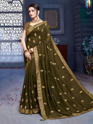 Grab This Pretty Attractive Saree In Olive Green Color. This Saree Is Fabricated On Art Silk Paired With Brocade Fabricated Blouse. Its Rich Fabric And Color Will Earn You Lots Of Compliments From Onlookers.