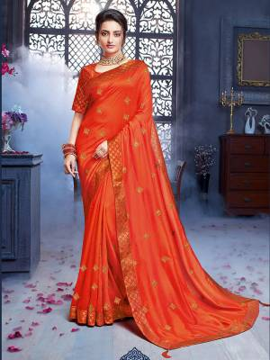 Grab This Pretty Attractive Saree In Orange Color. This Saree Is Fabricated On Art Silk Paired With Brocade Fabricated Blouse. Its Rich Fabric And Color Will Earn You Lots Of Compliments From Onlookers.