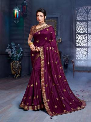 Grab This Pretty Attractive Saree In Dark Purple Color. This Saree Is Fabricated On Art Silk Paired With Brocade Fabricated Blouse. Its Rich Fabric And Color Will Earn You Lots Of Compliments From Onlookers.