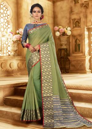 Flaunt Your Rich And Elagant Taste Wearing This Pretty Attractive Saree In Light Green Color Paired With Contrasting Grey Colored Blouse. This Saree And Blouse Are Fabricated On Khadi Silk Which Also Gives A Rich Look To Your Personality. Buy Now.