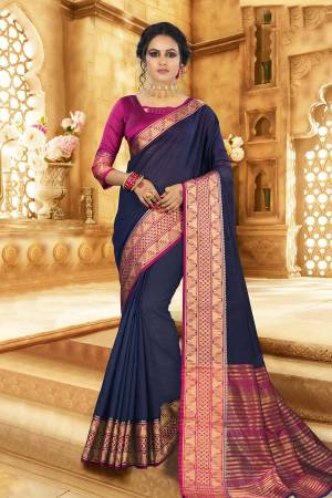 Flaunt Your Rich And Elagant Taste Wearing This Pretty Attractive Saree In Navy Blue Color Paired With Contrasting Magenta Pink Colored Blouse. This Saree And Blouse Are Fabricated On Khadi Silk Which Also Gives A Rich Look To Your Personality. Buy Now.