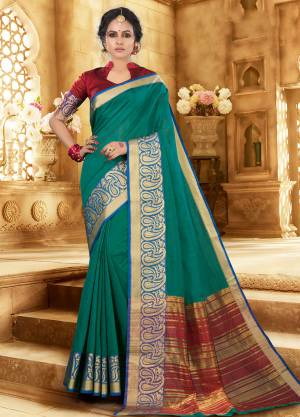 Flaunt Your Rich And Elagant Taste Wearing This Pretty Attractive Saree In Teal Green Color Paired With Contrasting Maroon Colored Blouse. This Saree And Blouse Are Fabricated On Khadi Silk Which Also Gives A Rich Look To Your Personality. Buy Now.