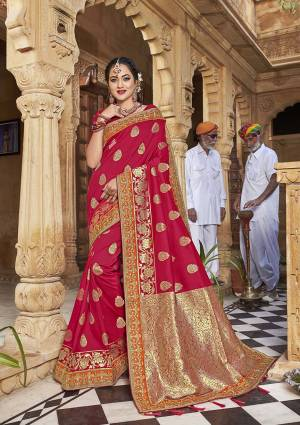 Celebrate This Festive In This Rich And Elegant Looking Silk Based Designer Saree In Dark Pink Color Paired With Red Colored Blouse. This Saree Is Fabricated On Satin Jacquard Silk Paired With Art Silk Fabricated Blouse. Its Rich Fabric And Color Will Earn You Lots Of Compliments From Onlookers.
