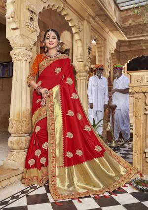 Celebrate This Festive In This Rich And Elegant Looking Silk Based Designer Saree In Red Color Paired With Orange Colored Blouse. This Saree Is Fabricated On Satin Jacquard Silk Paired With Art Silk Fabricated Blouse. Its Rich Fabric And Color Will Earn You Lots Of Compliments From Onlookers.