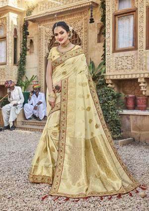 For A Royal Look, Grab This Designer Saree In Cream Color Paired With Cream Colored Blouse. This Saree Is Fabricated On Satin Jacquard Silk Paired With Art Silk Fabricated Blouse. It Is Beautified With Attractive Embroidered Lace Border And Blouse.
