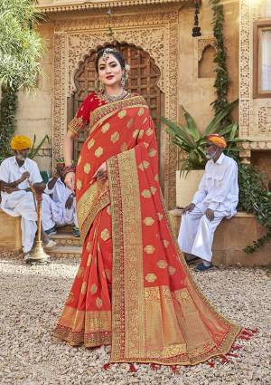 For A Royal Look, Grab This Designer Saree In Orange Color Paired With Contrasting Red Colored Blouse. This Saree Is Fabricated On Satin Jacquard Silk Paired With Art Silk Fabricated Blouse. It Is Beautified With Attractive Embroidered Lace Border And Blouse.