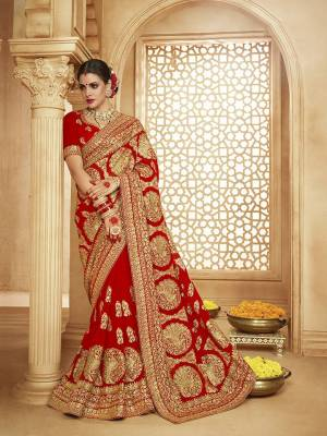 Here Is A Very Attractive Heavy Designer Bridal Saree For The Upcoming Wedding Season In Red Color Paired With Embroidered Red Colored Blouse. It Is Beautified With Heavy Jari Embroidery With Stone Work. Buy This Lovely Bridal Saree Now.