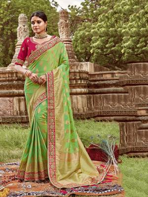 Here Is A Very Pretty Heavy Designer Saree. This Beautiful Light Green Colored Heavy Embroidered Saree Is Fabricated On Jacquard Silk Paired With An Embroidered Dark Pink Colored Art Silk Fabricated Blouse. Buy This Pretty Saree Now.