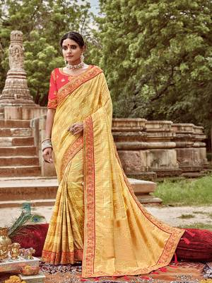 Here Is A Very Pretty Heavy Designer Saree. This Beautiful Light Yellow Colored Heavy Embroidered Saree Is Fabricated On Jacquard Silk Paired With An Embroidered Dark Peach Colored Art Silk Fabricated Blouse. Buy This Pretty Saree Now.