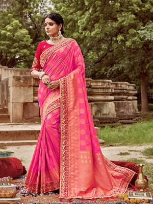 Celebrate This Festive And Wedding Season With This Heavy Designer Saree In Pink Color Paired With Dark Pink Colored Blouse. This Pretty Saree Is Fabricated On Jacquard Silk Paired With Art Silk Fabricated Blouse.