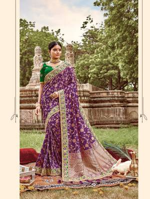 Here Is A Very Pretty Heavy Designer Saree. This Beautiful Purple Colored Heavy Embroidered Saree Is Fabricated On Jacquard Silk Paired With An Embroidered Green Colored Art Silk Fabricated Blouse. Buy This Pretty Saree Now.