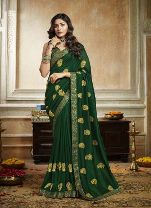 Grab This Pretty Attractive Saree In Dark Green Color. This Saree Is Fabricated On Soft Art Silk Paired With Brocade Fabricated Blouse. It Has Attractive Jari Embroidered Motifs Highlited With Stone Work. Its Rich Fabric And Color Will Earn You Lots Of Compliments From Onlookers.