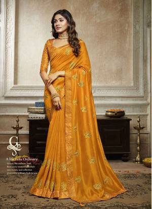 Grab This Pretty Attractive Saree In Musturd Yellow Color. This Saree Is Fabricated On Soft Art Silk Paired With Brocade Fabricated Blouse. It Has Attractive Jari Embroidered Motifs Highlited With Stone Work. Its Rich Fabric And Color Will Earn You Lots Of Compliments From Onlookers.