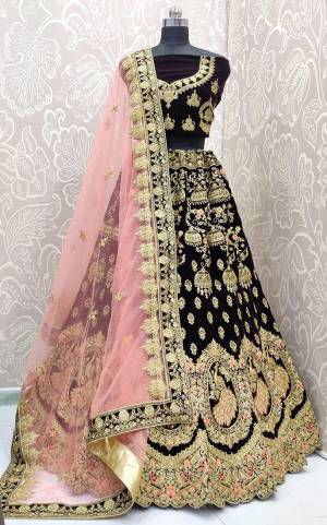 Look Pretty In This Trending Color For Bridal Wear?In Dark Purple Color Paired With Contrasting Baby Pink Colored Dupatta. This Very Beautiful Heavy Designer Lehenga Choli Is Fabricated on Velvet Paired With Net Fabricated Dupatta. Buy Now. Its Attractive Embroidery And Color Will Definitlely Earn You Lots Of Compliments From Onlookers.