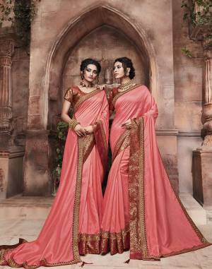 Grab This Pretty Attractive Saree In Dark Peach Color Paired With?Contrasting Red Colored Blouse. This Saree Is Fabricated On Soft Art Silk Paired With Brocade Fabricated Blouse. Its Rich Fabric And Color Will Earn You Lots Of Compliments From Onlookers.?