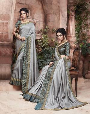 Grab This Pretty Attractive Saree In Grey Color Paired With?Contrasting Navy Blue Colored Blouse. This Saree Is Fabricated On Soft Art Silk Paired With Brocade Fabricated Blouse. Its Rich Fabric And Color Will Earn You Lots Of Compliments From Onlookers.?
