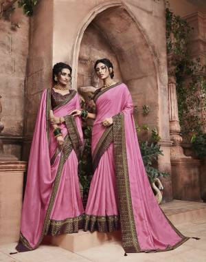 Grab This Pretty Attractive Saree In Pink Color Paired With?Contrasting Wine Colored Blouse. This Saree Is Fabricated On Soft Art Silk Paired With Brocade Fabricated Blouse. Its Rich Fabric And Color Will Earn You Lots Of Compliments From Onlookers.?