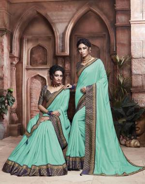 Grab This Pretty Attractive Saree In Turquoise Blue Color Paired With?Contrasting Navy Blue Colored Blouse. This Saree Is Fabricated On Soft Art Silk Paired With Brocade Fabricated Blouse. Its Rich Fabric And Color Will Earn You Lots Of Compliments From Onlookers.?
