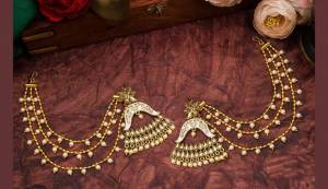 Grab This Heavy Designer Earrings For The Upcoming Wedding Season. The New Trendy And Designer Earrings Can Be Paired With Any Kind Of Ethnic Attire. Also It Will Earn You Lots Of Compliments From Onlookers.