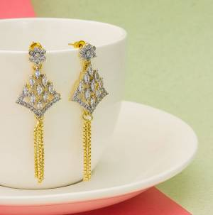 Grab This Pretty Earrings Set In Golden Color. This Lovely Design Is Beautified With Attractive Diamond Work. You Can Pair This Up With Any Colored Attire. Buy This Pretty Piece Now