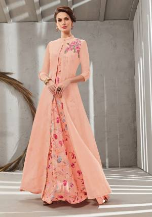 Grab This Beautiful Designer Readymade Gown In Two Layer Consist Of A Printed Inner And Plain Jacket In Peach Color. Its Embroidered Jacket Is Fabricated On Poly Organdy Paired With Digital Printed Rayon Cotton Inner. Buy This Readymade Gown Now.