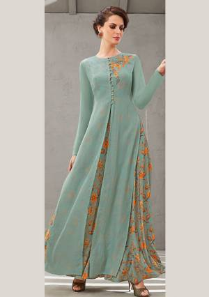 Grab This Beautiful Designer Readymade Gown In Two Layer Consist Of A Printed Inner And Plain Jacket In Dusty Blue Color. Its Embroidered Jacket Is Fabricated On Poly Organdy Paired With Digital Printed Rayon Cotton Inner. Buy This Readymade Gown Now.