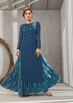Grab This Beautiful Designer Readymade Gown In Two Layer Consist Of A Printed Inner And Plain Jacket In Blue Color. Its Embroidered Jacket Is Fabricated On Poly Organdy Paired With Digital Printed Rayon Cotton Inner. Buy This Readymade Gown Now.