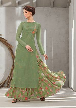 Grab This Beautiful Designer Readymade Gown In Two Layer Consist Of A Printed Inner And Plain Jacket In Olive Green Color. Its Embroidered Jacket Is Fabricated On Poly Organdy Paired With Digital Printed Rayon Cotton Inner. Buy This Readymade Gown Now.