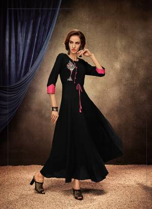 Add This Pretty Readymade Designer Gown To Your Wardrobe In Black Color. This Pretty Gown Is Fabricated On Rayon Beautified With Thread Embroidery. Its Fabric Is Soft Towards Skin, Light Weight And Easy To Carry All Day Long.