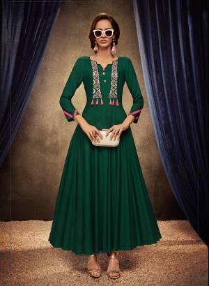 Add This Pretty Readymade Designer Gown To Your Wardrobe In Green Color. This Pretty Gown Is Fabricated On Rayon Beautified With Thread Embroidery. Its Fabric Is Soft Towards Skin, Light Weight And Easy To Carry All Day Long.