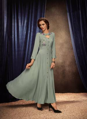 Flaunt Your Rich And Elegant Taste Wearing This Designer Readymade Long Gown In Grey Color. This  Pretty Gown Is Fabricated On Rayon Beautified With Thread Work. Its Fabric Is Soft Towards Skin And Easy To Carry All Day Long.