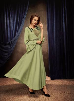 Flaunt Your Rich And Elegant Taste Wearing This Designer Readymade Long Gown In Light Green Color. This  Pretty Gown Is Fabricated On Rayon Beautified With Thread Work. Its Fabric Is Soft Towards Skin And Easy To Carry All Day Long.