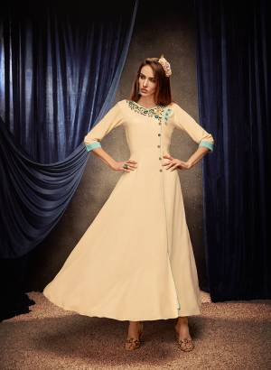 Flaunt Your Rich And Elegant Taste Wearing This Designer Readymade Long Gown In Cream Color. This  Pretty Gown Is Fabricated On Rayon Beautified With Thread Work. Its Fabric Is Soft Towards Skin And Easy To Carry All Day Long.