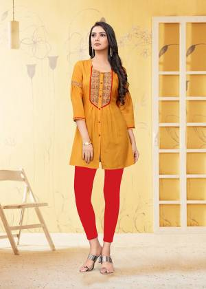 Here Is A Very Pretty Readymade Short Kurti In Yellow Color Fabricated On Rayon Flex. It Is Beautified With Thread Work And Available In All Regular Sizes.