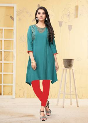 Grab This Readymade Kurti In Blue Color Fabricated On Rayon Flex. It Is Light In Weight And Easy To Carry All Day Long.