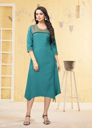 Here Is A Very Pretty Readymade Kurti In Blue Color Fabricated On Rayon Flex. It Is Beautified With Thread Work And Available In All Regular Sizes.