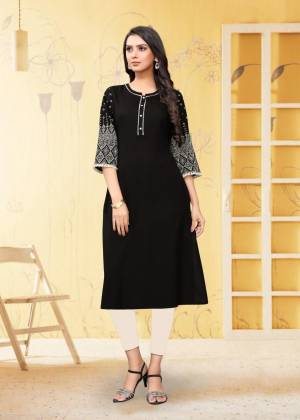 For Your Semi-Casual Wear, Grab This Readymade Kurti In Black Color Fabricated On Rayon Flex. It Is Beautified With DetailedThread Work. You Can Pair This Up With Same Or Contrasting Colored Bottom. Buy Now.